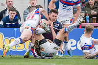 Picture by Allan McKenzie/SWpix.com - 08/04/2018 - Rugby League - Betfred Super League - Wakefield Trinity v Leeds Rhinos - The Mobile Rocket Stadium, Wakefield, England - Leeds's Tom Briscoe is tackled short of the try line by Wakefield.