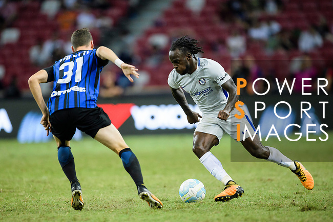 Chelsea Midfielder Victor Moses (R) competes for the ball with FC Internazionale Defender Federico Valietti during the International Champions Cup 2017 match between FC Internazionale and Chelsea FC on July 29, 2017 in Singapore. Photo by Weixiang Lim / Power Sport Images