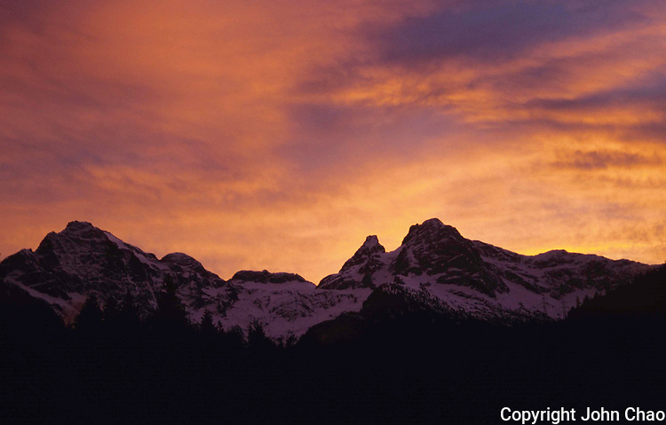 Sunset-colored sky behind the North Cascades mountain range, Washington State