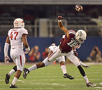 STAFF PHOTO BEN GOFF  @NWABenGoff -- 09/27/14 Arkansas defender Rohan Gaines, obscured, breaks up a pass intended for Texas A&M wide receiver Edward Pope during the first quarter of the Southwest Classic at AT&T Stadium in Arlington, Texas on Saturday September 27, 2014.