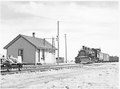 D&amp;RGW #497 with northbound freight passing Moffat depot.  Hand car on siding.<br /> D&amp;RGW  Moffat, CO  Taken by Richardson, Robert W. - 5/16/1949