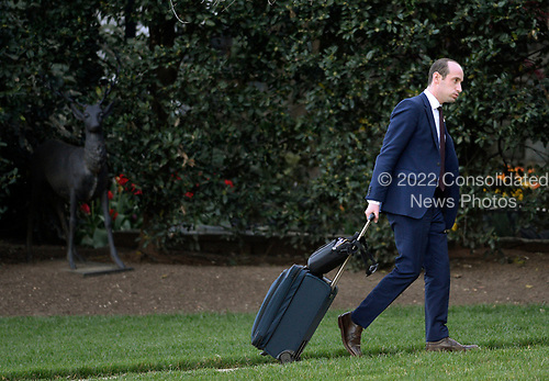 Stephen Miller, United States President Donald Trump's senior policy advisor  walks on the south Lawn after arriving at the White House in Washington, DC, April 9, 2017.<br /> Credit: Olivier Douliery / Pool via CNP