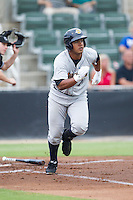 Jackson Valera (27) of the Charleston RiverDogs hustles down the first base line against the Kannapolis Intimidators at CMC-NorthEast Stadium on June 28, 2014 in Kannapolis, North Carolina.  The Intimidators defeated the RiverDogs 4-3. (Brian Westerholt/Four Seam Images)