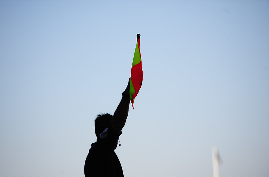 The assistant referee holds his flag aloft to signal a decision<br /> <br /> Photographer Chris Vaughan/CameraSport<br /> <br /> The EFL Sky Bet League One - Scunthorpe United v Bolton Wanderers - Saturday 8th April 2017 - Glanford Park - Scunthorpe<br /> <br /> World Copyright &copy; 2017 CameraSport. All rights reserved. 43 Linden Ave. Countesthorpe. Leicester. England. LE8 5PG - Tel: +44 (0) 116 277 4147 - admin@camerasport.com - www.camerasport.com
