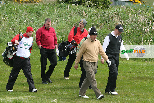 Des Smyth with his son Greg as caddy during the Pro-Am at the Irish Open in Co.Louth Golf Club,  Baltray....Photo NEWSFILE/Jenny Matthews.(Photo credit should read Jenny Matthews/NEWSFILE)....This Picture has been sent you under the condtions enclosed by:.Newsfile Ltd..The Studio,.Millmount Abbey,.Drogheda,.Co Meath..Ireland..Tel: +353(0)41-9871240.Fax: +353(0)41-9871260.GSM: +353(0)86-2500958.email: pictures@newsfile.ie.www.newsfile.ie.FTP: 193.120.102.198.