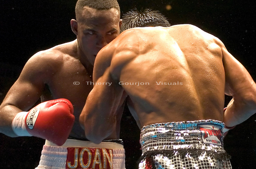 Joan Guzman on the attack against Terdsak Jandaeng (r) during their WBO Featherweight Eliminator Fight at the Westchester County Center, White Plains, NY on 08.26.2005..Guzman won by unanimous decision.