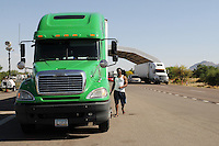 Nogales, Arizona -The driver of this semi-trailer who was stopped for a secondary inspection at a Border Patrol checkpoint prepares to leave after being subjected to additional questioning, and his vehicle searched for illegal contest through an X-ray mobile unit. Border Patrol checkpoints serve as inspection stations to detect illegal immigration and drug smuggling. Border Patrol agents assigned to fixed traffic checkpoints have wide discretion to stop vehicles for brief questioning and inspection of its occupants and its contents. This checkpoint is part of the Border Patrol Tucson Sector. Agent Photo by Eduardo © 2012