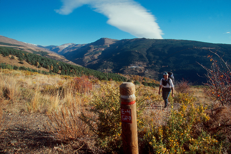 Spain, Hiking past a marker on the GR-7 cross Europe Trail through the Las Alpujarras in the Sierra Nevada (mountains), Europe,.