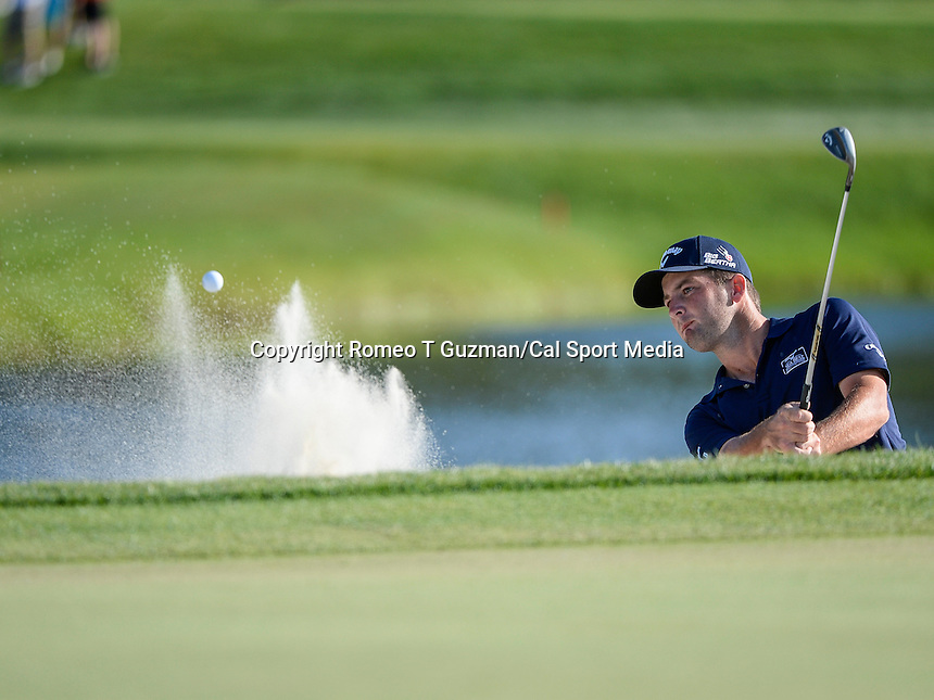 March 23, 2014 - Orlando, FL, U.S: Matt Every hits out of the green side bunker on #17 during final round golf action of the Arnold Palmer Invitational presented by Mastercard held at Arnold Palmer's Bay Hill Club & Lodge in Orlando, FL