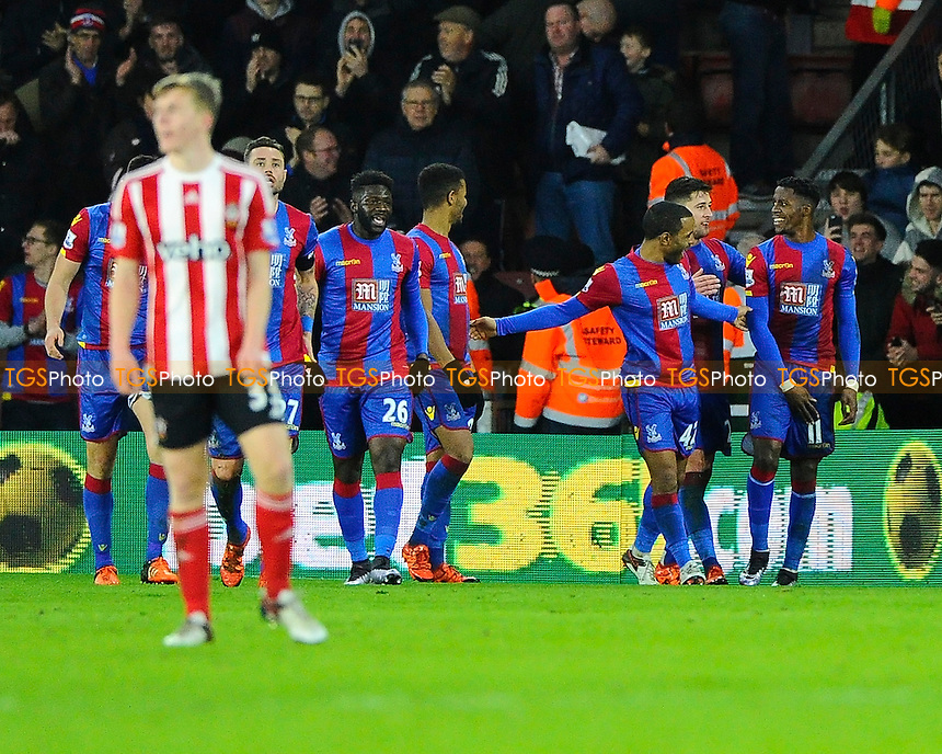 Wilfried Zaha of Crystal Palace right is congratulated after scoring the second Crystal Palace goal during Southampton vs Crystal Palace at St Mary's Stadium