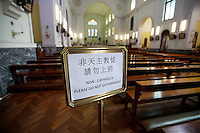 A sign inside the Macao Cathedral.<br /> <br /> To license this image, please contact the National Geographic Creative Collection:<br /> <br /> Image ID: 1973141 <br />  <br /> Email: natgeocreative@ngs.org<br /> <br /> Telephone: 202 857 7537 / Toll Free 800 434 2244<br /> <br /> National Geographic Creative<br /> 1145 17th St NW, Washington DC 20036