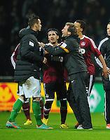 FUSSBALL   1. BUNDESLIGA    SAISON 2012/2013    17. Spieltag   SV Werder Bremen - 1. FC Nuernberg                     16.12.2012 Co-Trainer Wolfgang Rolf (re) haelt Marko Arnautovic (li, beide SV Werder Bremen) zurueck.