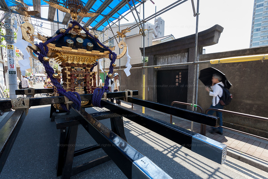 A mikoshi at rest during the Sanja matsuri, Asakusa, Tokyo, Japan. Sunday May 21st 2017 . The Sanja matsuri (Three shrines festival) is one of the biggest Shinto festivals in Japan. It takes place for 3 days around the third weekend of May and features over 100 large and small mikoshi, or portable shrines, which are paraded around the streets of the historic Asakusa district in Tokyo. to bring blessings and good luck on the inhabitants. The events attracts up to 2 million visitors each year.