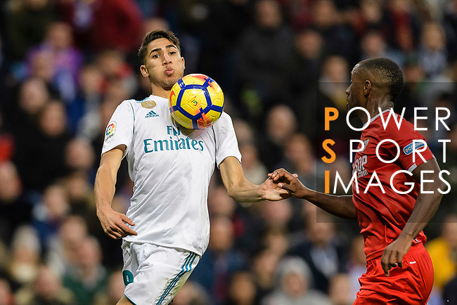 Achraf Hakimi of Real Madrid (L) in action against Lionel Carole of Sevilla FC (R) during La Liga 2017-18 match between Real Madrid and Sevilla FC at Santiago Bernabeu Stadium on 09 December 2017 in Madrid, Spain. Photo by Diego Souto / Power Sport Images