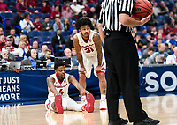 NWA Democrat-Gazette/CHARLIE KAIJO Arkansas Razorbacks guard Daryl Macon (4) and guard Anton Beard (31) talk during the Southeastern Conference Men's Basketball Tournament, Thursday, March 8, 2018 at Scottrade Center in St. Louis, Mo.