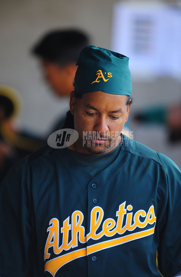 Mar. 19, 2012; Phoenix, AZ, USA; Oakland Athletics designated hitter Manny Ramirez in the dugout in the fourth inning against the Arizona Diamondbacks during a spring training game at Phoenix Municipal Stadium.  Mandatory Credit: Mark J. Rebilas-