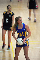 Dunedin's Rachael Horrocks in action during the 2015 National Netball Championship match between Dunedin (blue and yellow) and Hutt Valley (green and gold) at ASB Sports Centre, Kilbirnie, Wellington, New Zealand on Tuesday, 29 September 2015. Photo: Dave Lintott / lintottphoto.co.nz