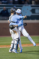 North Carolina Tar Heels catcher Cody Roberts (11) gets a hug from relief pitcher Josh Hiatt (31) after he closed out the win over the Kentucky Wildcats at Boshmer Stadium on February 17, 2017 in Chapel Hill, North Carolina.  The Tar Heels defeated the Wildcats 3-1.  (Brian Westerholt/Four Seam Images)