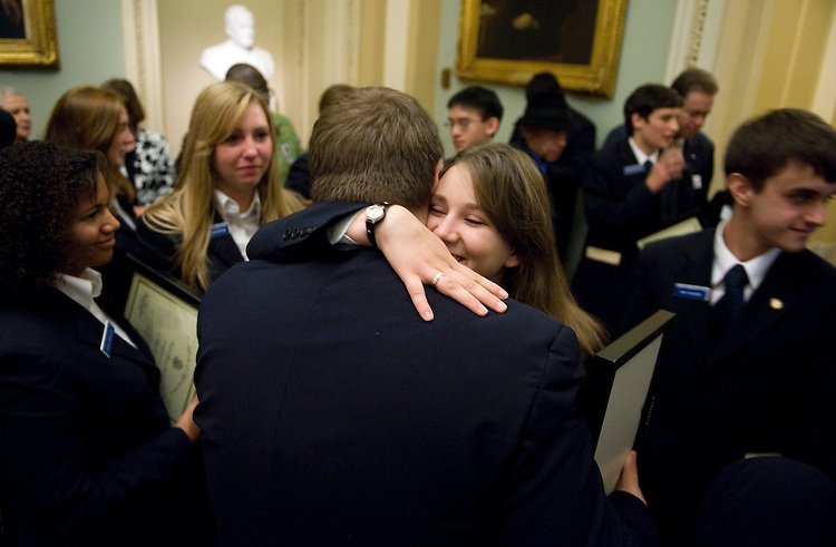 Ariel O'Shields, 17, of Phoenix, hugs D.R. Ball, 17, of Kentucky, in the Ohio Clock Chamber after the U.S. Senate Page School Awards Assembly and Farewell Reception, June 5, 2009.