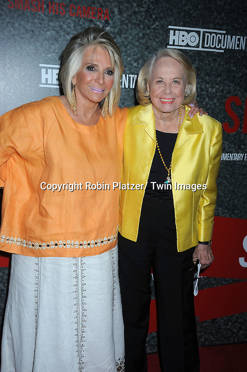 """Sheila Nevins and Liz Smith  posing for photographers at the Ron Galella HBO Documentary """"Smash His Camera"""" on June 1, 2010 at the Museum of Modern Art in New York City."""
