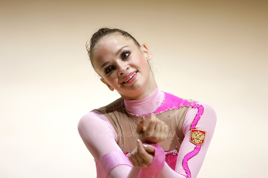 Marina Shpekt of Russia smiles during finish of her ribbon routine during All-Around competition at 2006 Thiais Grand Prix in Paris, France on March 25, 2006.  (Photo by Tom Theobald)