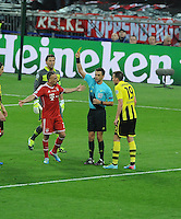 25.05.2013 London, England. The referee shows a yellow card to Franck Ribery of Bayern Munich during the 2013 UEFA Champions League Final between Bayern Munich and Borussia Dortmund from Wembley Stadium. Picture Credit: Tommy Grealy/actionshots.ie