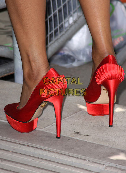 BEVERLEY KNIGHT's shoes .Attending the Ivor Novello Awards, Grosvenor House Hotel, London, England, UK, May 19th 2011..arrivals feet detail heels  red satin shoes  platform .CAP/AH.©Adam Houghton/Capital Pictures.