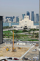 QATAR, Doha,museum for islamic arts infront of skyscrapers at East Bay / KATAR, Doha, Museum fuer islamische Kunst vor Wolkenkratzern der Eastbay