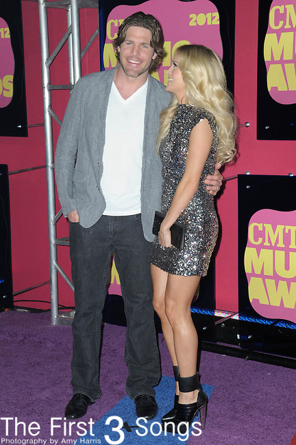 Carrie Underwood and Mike Fisher attends the 11th Annual CMT Awards in Nashville, TN on June 6, 2012.