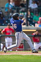 Eduardo Diaz (36) of the Missoula Osprey follows through on his swing against the Billings Mustangs at Dehler Park on August 20, 2017 in Billings, Montana.  The Osprey defeated the Mustangs 6-4.  (Brian Westerholt/Four Seam Images)