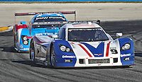 The #9 Chevrolet Corvette DP of Joao Barbosa, Terry Borcheller, Max Papis and JC France leads another car during the Rolex 24 at Daytona, Daytona International Speedway, Daytona Beach, FL, January 2011.  (Photo by Brian Cleary/www.bcpix.com)