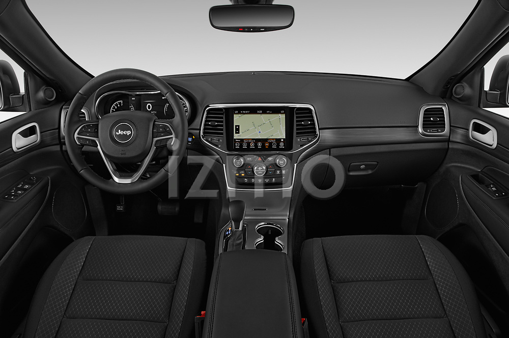 Stock photo of straight dashboard view of 2019 JEEP Grand-Cherokee Laredo-E 5 Door SUV Dashboard