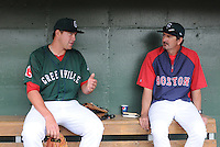 Pitcher Brian Johnson (28) of the Greenville Drive, left, talks with pitching coach Paul Abbott after pitching in his Class A debut against the Charleston RiverDogs on Sunday, April 7, 2013, at Fluor Field at the West End in Greenville, South Carolina. Johnson was selected by the Boston Red Sox in the 1st Round (31st overall) in the 2012 First-Year Player Draft out of the University of Florida. Charleston won, 5-0. Johnson is the No. 15 prospect for the Boston Red Sox, according to Baseball America. (Tom Priddy/Four Seam Images)