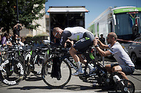 Steve Cummings (GBR/DimensionData) getting his race number pinned to his skin suit while in position warming up<br /> <br /> stage 13 (ITT): Bourg-Saint-Andeol - Le Caverne de Pont (37.5km)<br /> 103rd Tour de France 2016