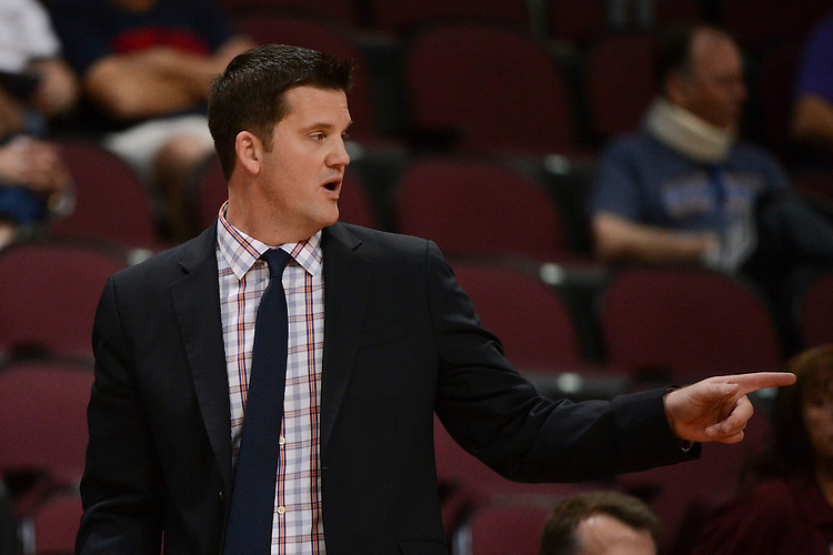 March 6, 2014; Las Vegas, NV, USA; Pepperdine Waves head coach Ryan Weisenberg instructs against the Santa Clara Broncos during the second half of the WCC Basketball Championships at Orleans Arena. The Waves defeated the Broncos 80-74.