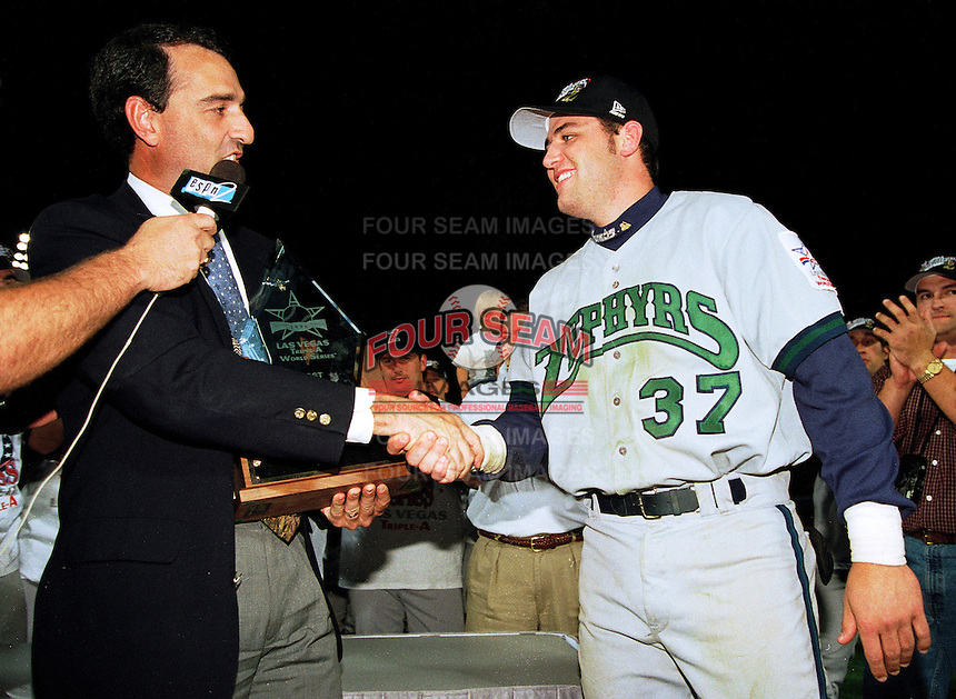 Lance Berkman of the New Orleans Zephyrs accepts the MVP award from International League President Randy Mobley after the 1998 AAA Championship Series against the Buffalo Bison at Cashman Field in Las Vegas, Nevada. (Larry Goren/Four Seam Images)