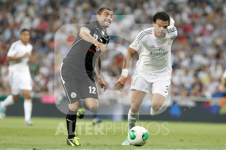 Real Madrid's Pepe (r) and Al Sadd's Leandro during Santiago Bernabeu Trophy.August 22,2013. (ALTERPHOTOS/Acero)