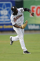 Birmingham Barons left fielder Jared Mitchell #4 throws from the outfield during the Southern League All-Star Game  at Smokies Park on June 19, 2012 in Kodak, Tennessee.  The South Division defeated the North Division 6-2. (Tony Farlow/Four Seam Images).
