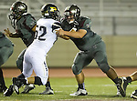 Torrance, CA 09/19/15 - Matthew Ho (Peninsula #52) and Chase Pitts (Torrance #80) in action during the Peninsula Panthers - Torrance Tartars Varsity football game at Torrance High School