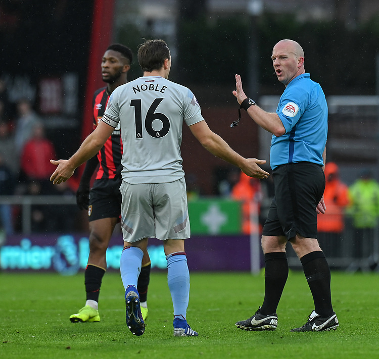 West Ham United's skipper Mark Noble disputes a challenge with referee Simon Hooper<br /> <br /> Photographer David Horton/CameraSport<br /> <br /> The Premier League - Bournemouth v West Ham United - Saturday 19 January 2019 - Vitality Stadium - Bournemouth<br /> <br /> World Copyright &copy; 2019 CameraSport. All rights reserved. 43 Linden Ave. Countesthorpe. Leicester. England. LE8 5PG - Tel: +44 (0) 116 277 4147 - admin@camerasport.com - www.camerasport.com