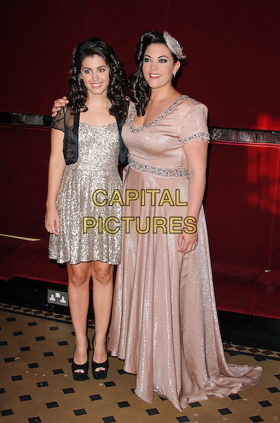 Katie Melua and Caro Emerald.World Hunger Day Concert - photocall held at the Royal Albert Hall, London, England..May 28th, 2012.full length gold sequins sequined dress sheer black pink dress silver embellished jewel encrusted trim feather in hair .CAP/CJ.©Chris Joseph/Capital Pictures.