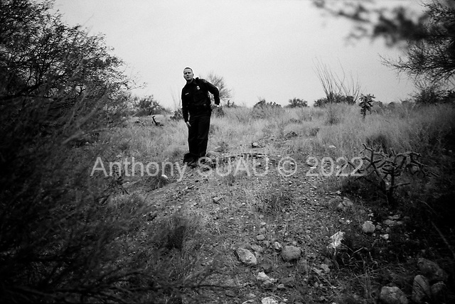 Three Points, Arizona.USA.October 23, 2006..A US border patrolman searches a field for illegal immigrates after catching four near the King Anvil Ranch- not far from the Mexican border. A trail of debris is found along a path under some trees and is suspected of begin used as a route for many...
