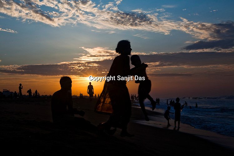 Tourists seen on Puri Beach along the Bay of Bengal in Puri, Orissa, India. A dip in its salty waters is believed to hold great religious significance, as a result these golden sand beaches sees is a never-ending rush of pilgrims and tourists. Photo: Sanjit Das/Panos