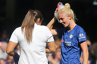 Sophie Ingle of Chelsea Women receives some treatment after suffering a head injury during Chelsea Women vs Tottenham Hotspur Women, Barclays FA Women's Super League Football at Stamford Bridge on 8th September 2019