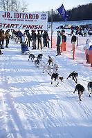 Saturday, February 24th, Knik, Alaska.  Jr. Iditarod musher MacKenzie Davis leaves start line on Knik Lake