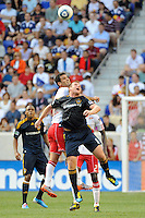 Rafael Marquez (4) of the New York Red Bulls and Chris Birchall (11) of the Los Angeles Galaxy go up for a header. The Los Angeles Galaxy defeated the New York Red Bulls 1-0 during a Major League Soccer (MLS) match at Red Bull Arena in Harrison, NJ, on August 14, 2010.