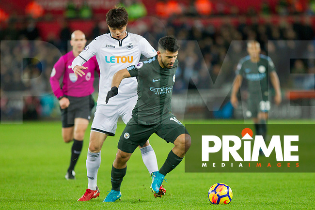 Sergio Aguero of Manchester City protects the ball from Ki Sung-Yueng of Swansea City during the EPL - Premier League match between Swansea City and Manchester City at the Liberty Stadium, Swansea, Wales on 13 December 2017. Photo by Mark  Hawkins / PRiME Media Images.