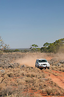 Offroad vehicle driving along a dusty track in the Gawler Ranges National Park, South Australia, Australia