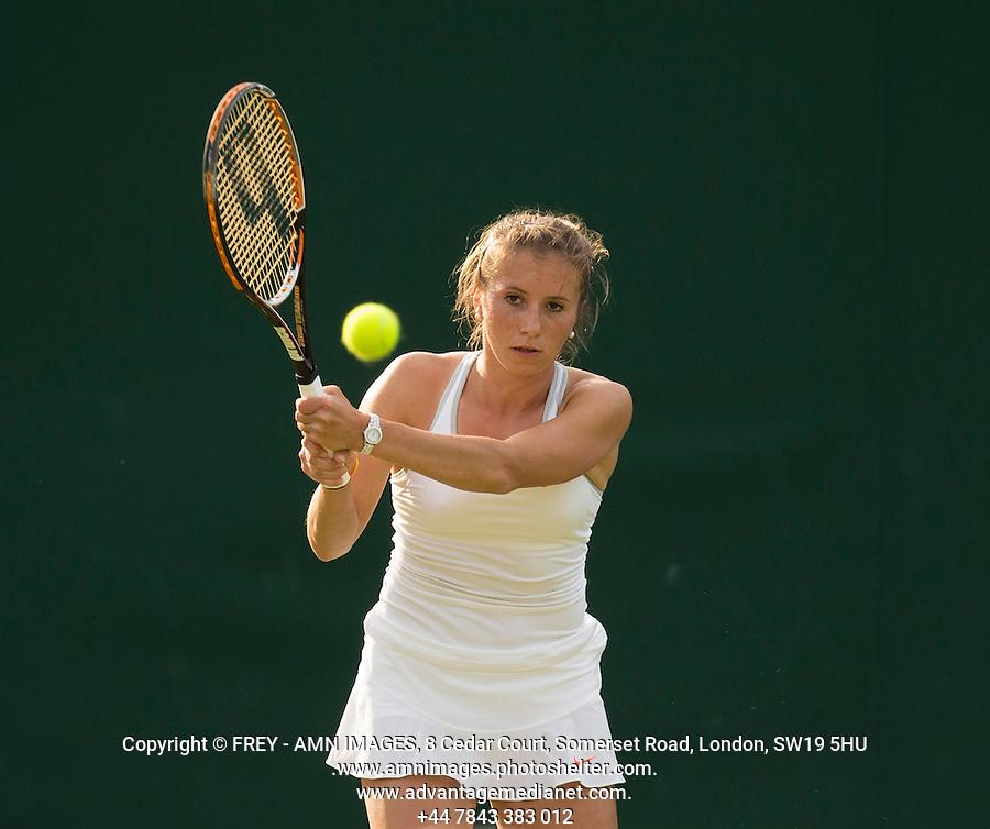 Annika Beck<br /> <br /> Tennis - The Championships Wimbledon  - Grand Slam -  All England Lawn Tennis Club  2013 -  Wimbledon - London - United Kingdom - Tuesday 25th June  2013. <br /> &copy; AMN Images, 8 Cedar Court, Somerset Road, London, SW19 5HU<br /> Tel - +44 7843383012<br /> mfrey@advantagemedianet.com<br /> www.amnimages.photoshelter.com<br /> www.advantagemedianet.com<br /> www.tennishead.net