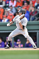 South Carolina Gamecocks right fielder Gene Cone (19) squares to bunt during a game against the Clemson Tigers at Fluor Field on March 5, 2016 in Greenville, South Carolina. The Tigers defeated the Gamecocks 5-0. (Tony Farlow/Four Seam Images)